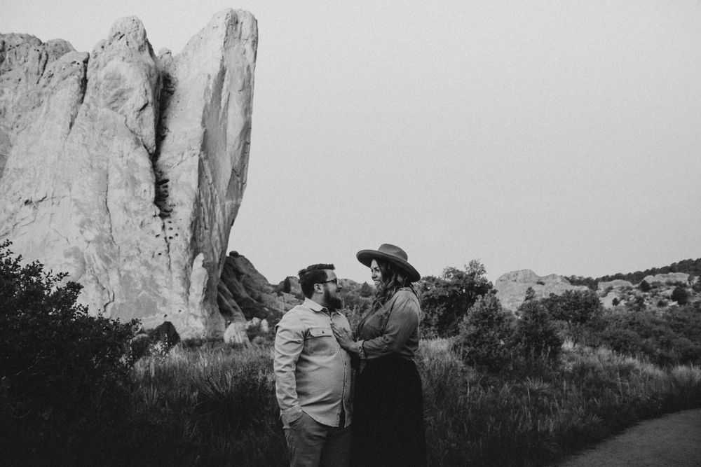 couple looking at each other during engagement photos in Colorado springs