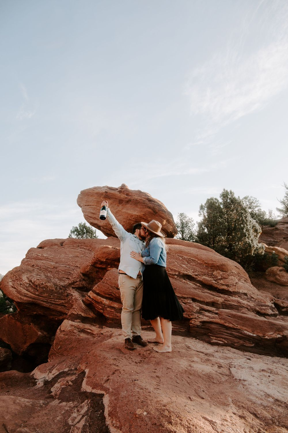 couple kissing after they got engaged in Colorado springs