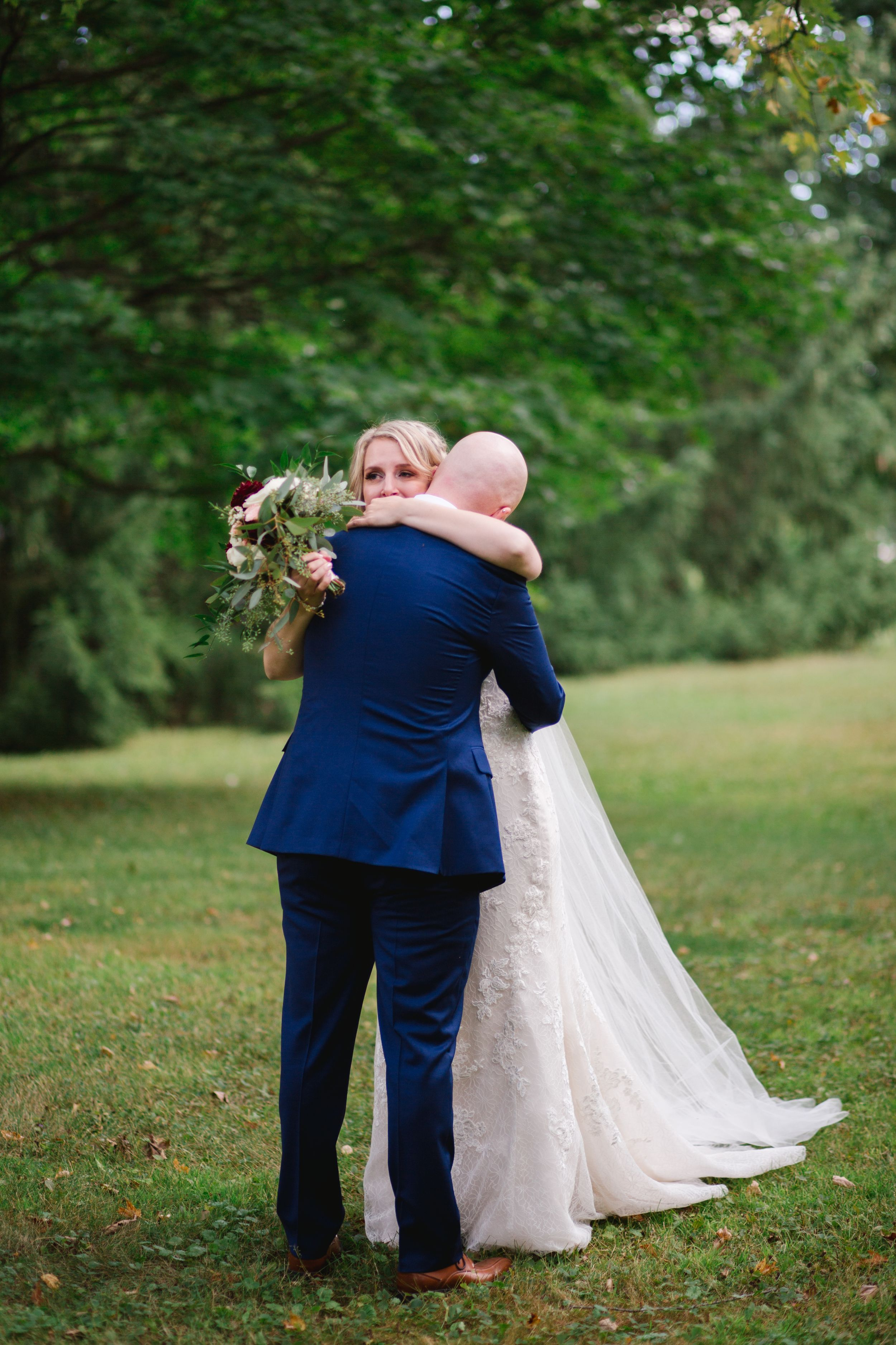 bride and groom hugging and crying in toronto