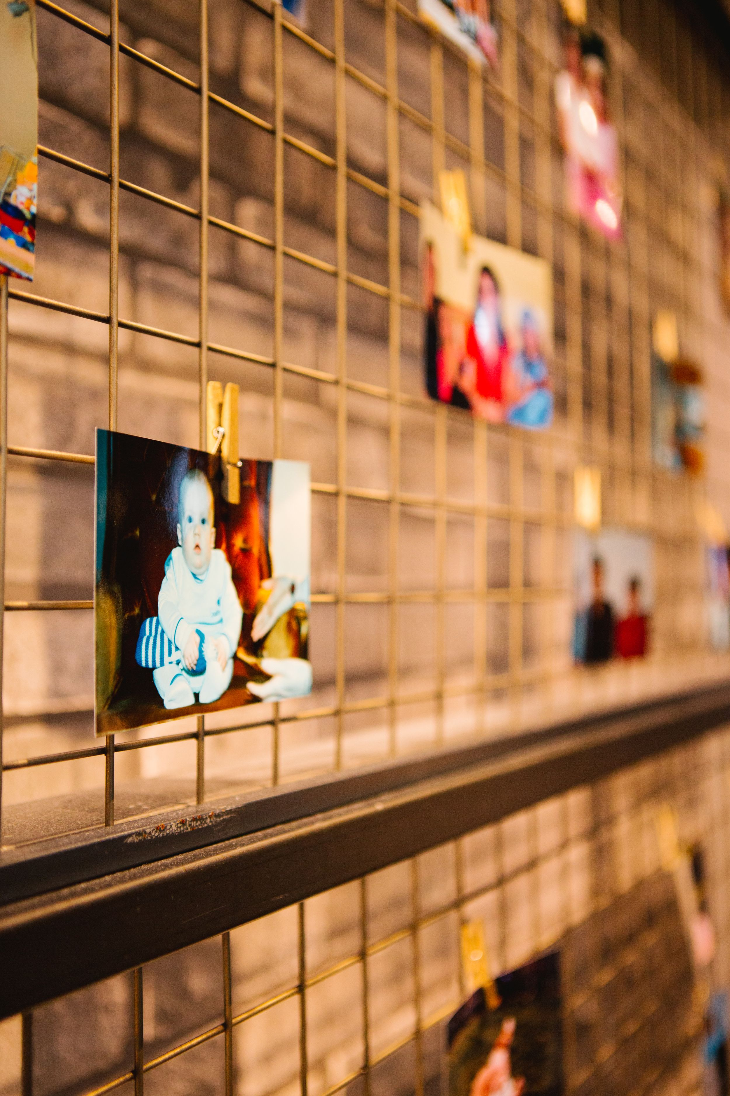 baby picture hung up on wire in industrial wedding venue toronto