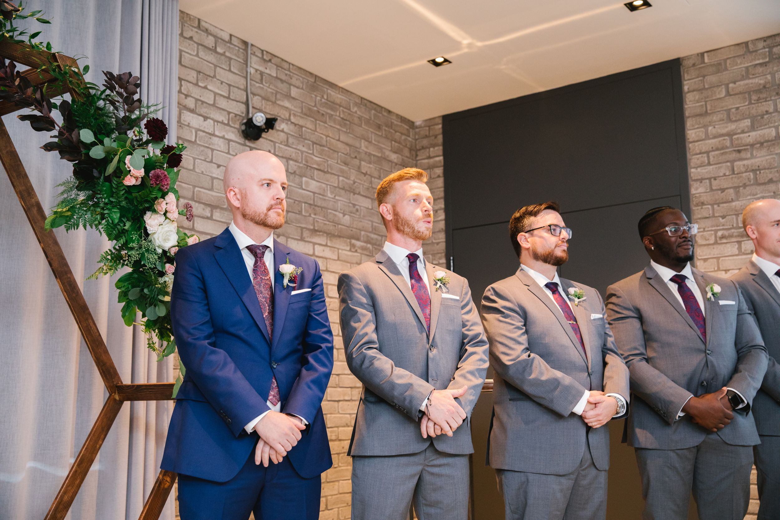 groom waiting for bride to walk down the aisle with his groomsmen