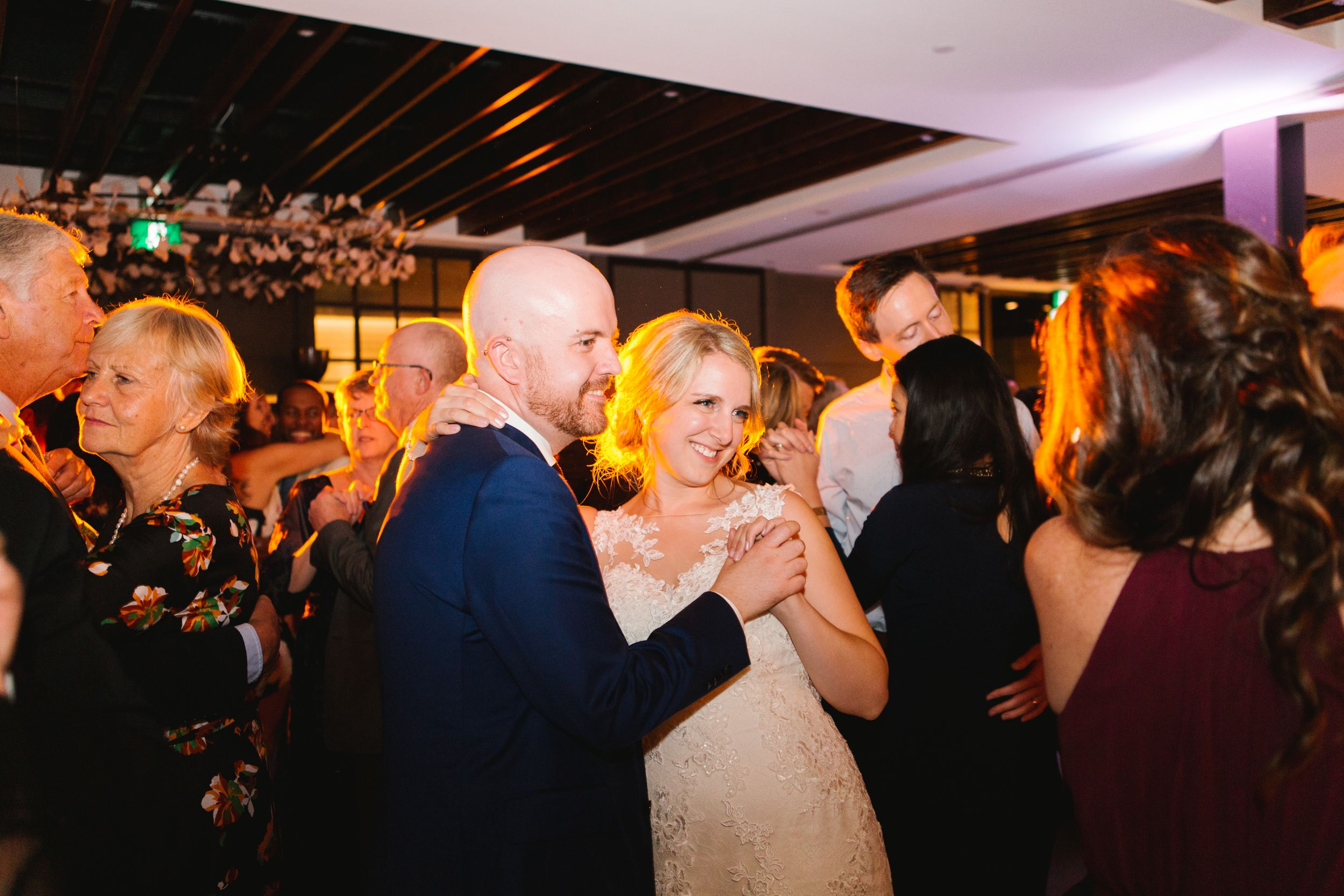 bride and groom slow dance during reception