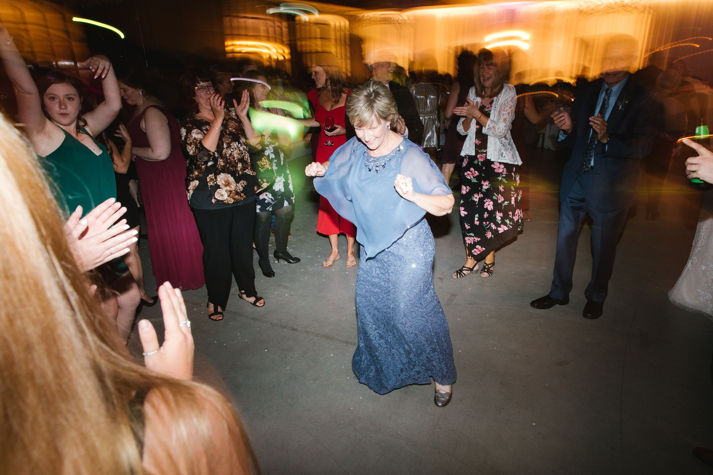 wedding guests dancing during reception