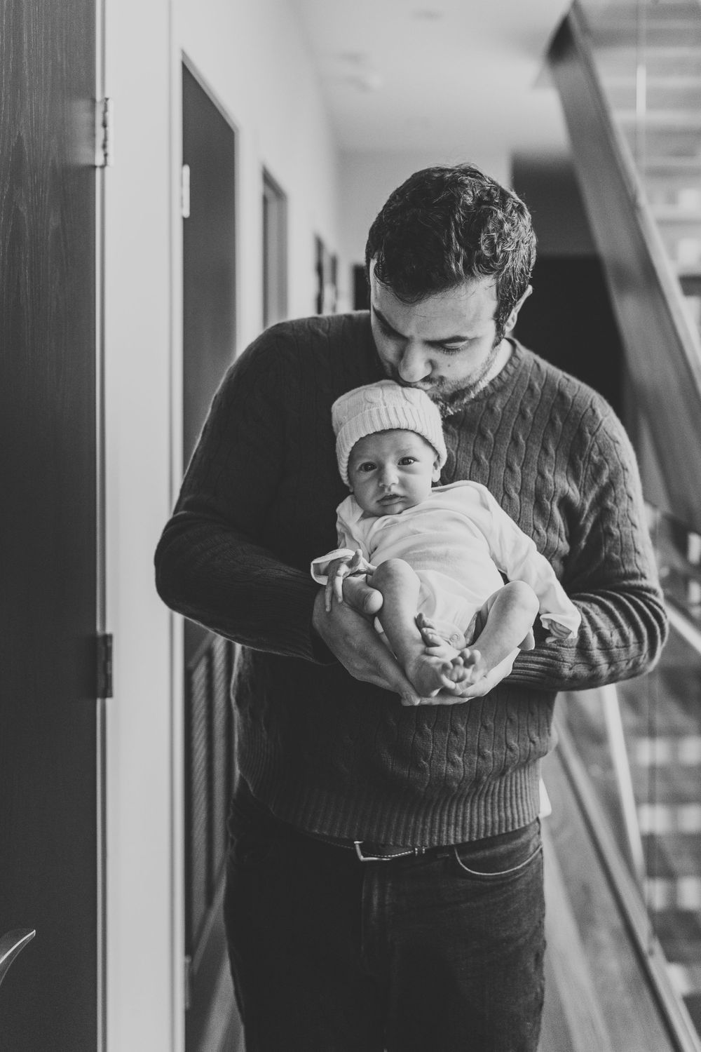 father holding baby girl Chicago newborn lifestyle session