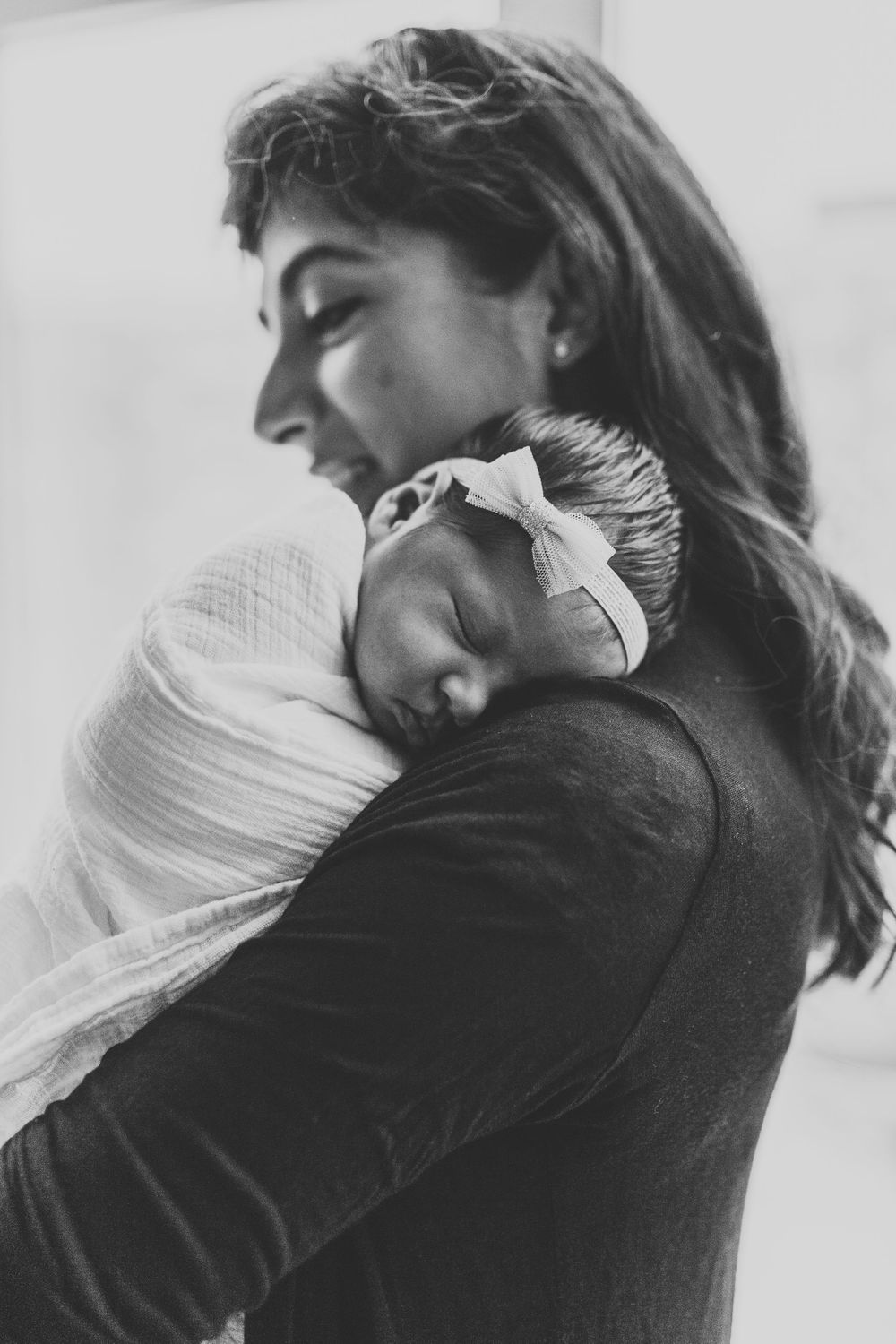 Mother holding her daughter during Chicago newborn lifestyle session