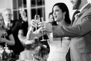 Bride and groom toast each other during the wedding reception.