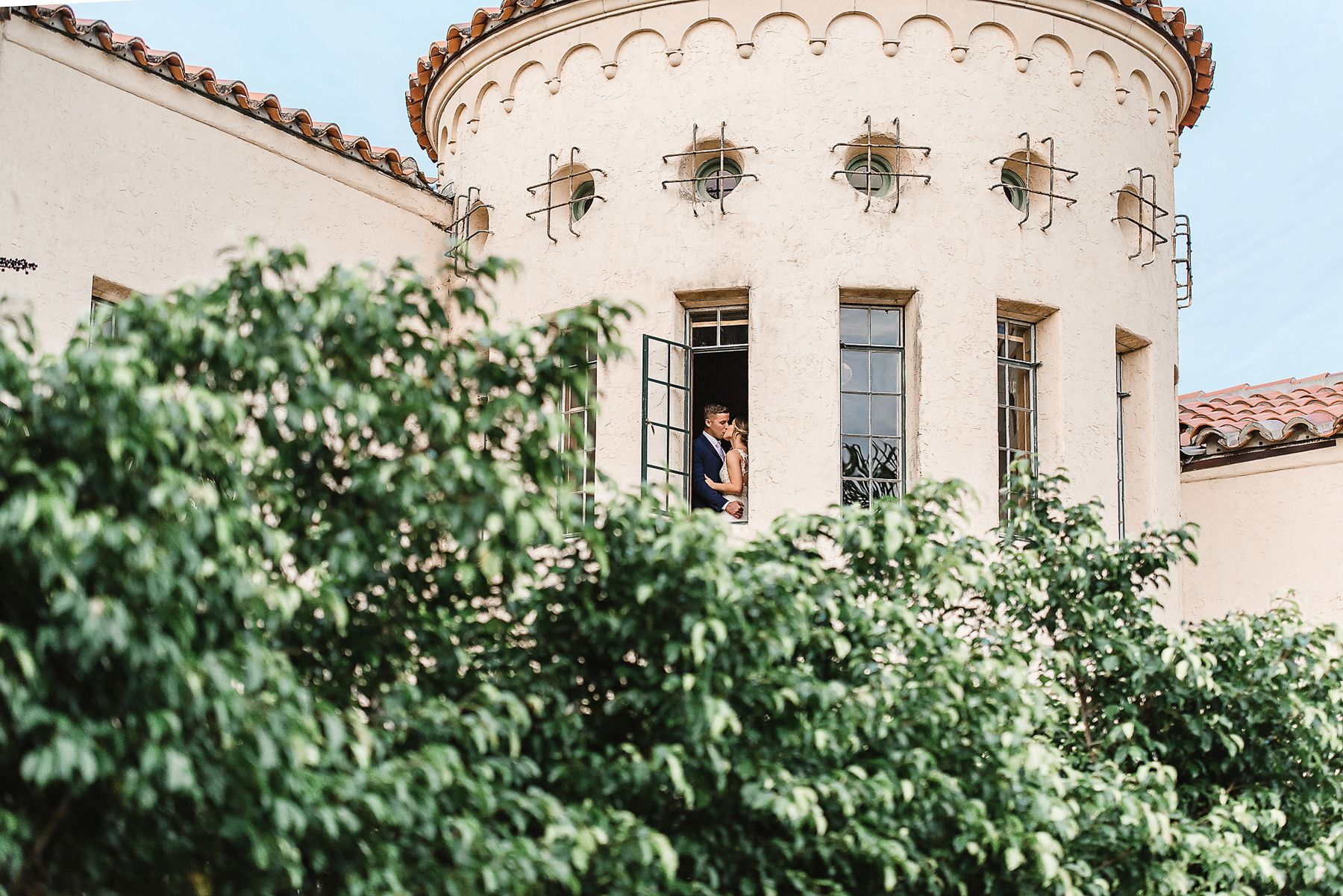 Bride and Groom in Tower at Powel Crosley Historic Estate by Sarasota Wedding Photographer