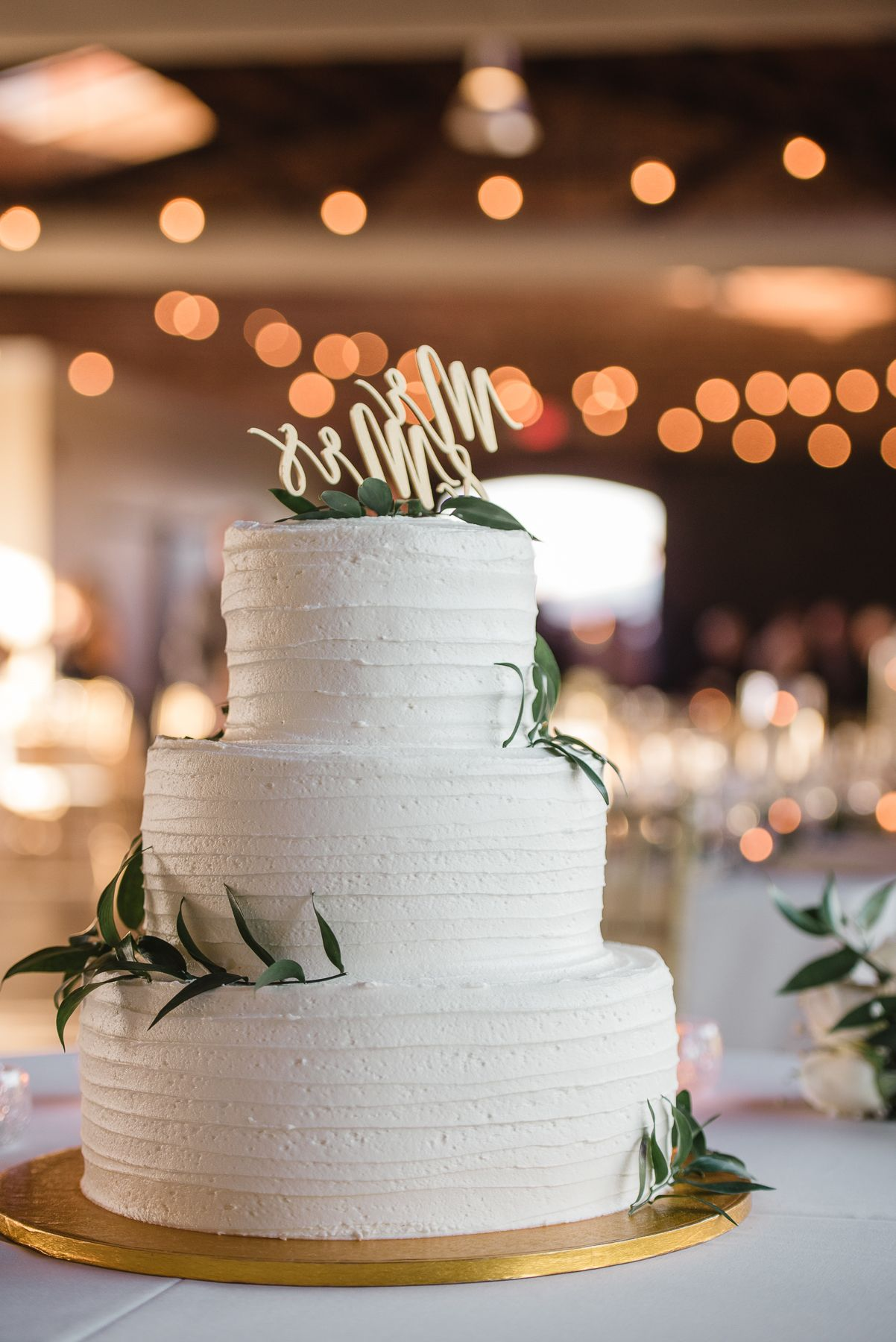 simple wedding cake with greenery at morean center in st pete urban wedding venue