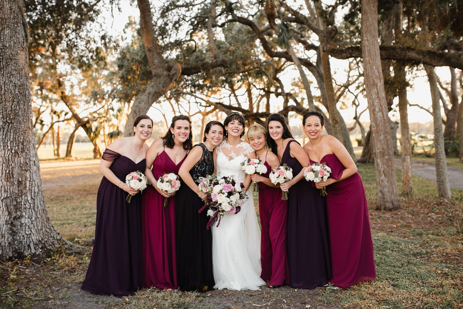 bridesmaids in burgundy and red ombre dresses at longboat key blub wedding