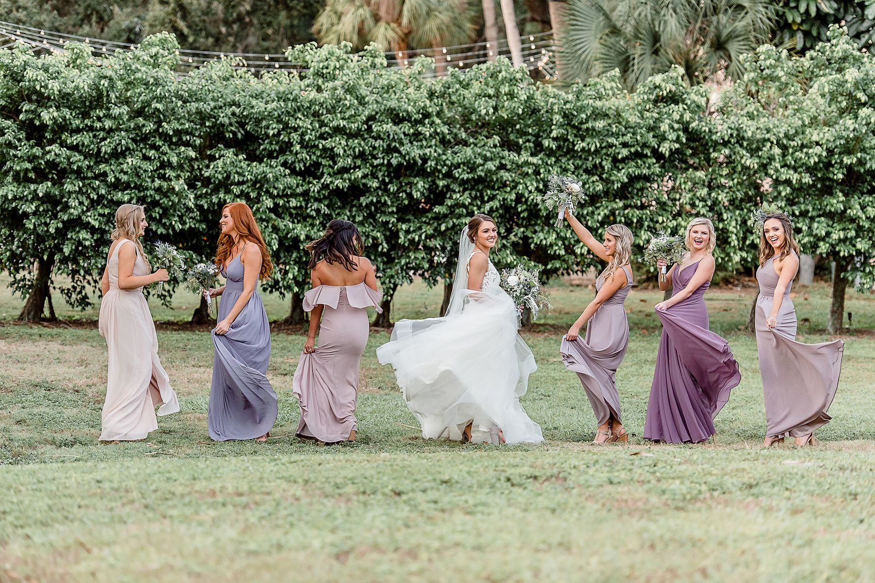 Purple Lavender Plum Ombre Bridesmaids Spinning at Powel Crosley Estate Wedding by Sarasota Wedding Photographer