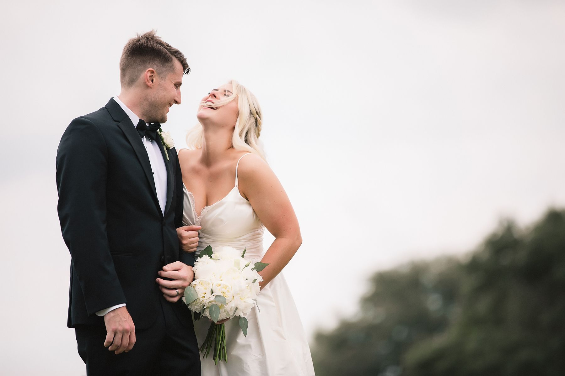 bride laughing with groom at Lakewood Ranch country club wedding