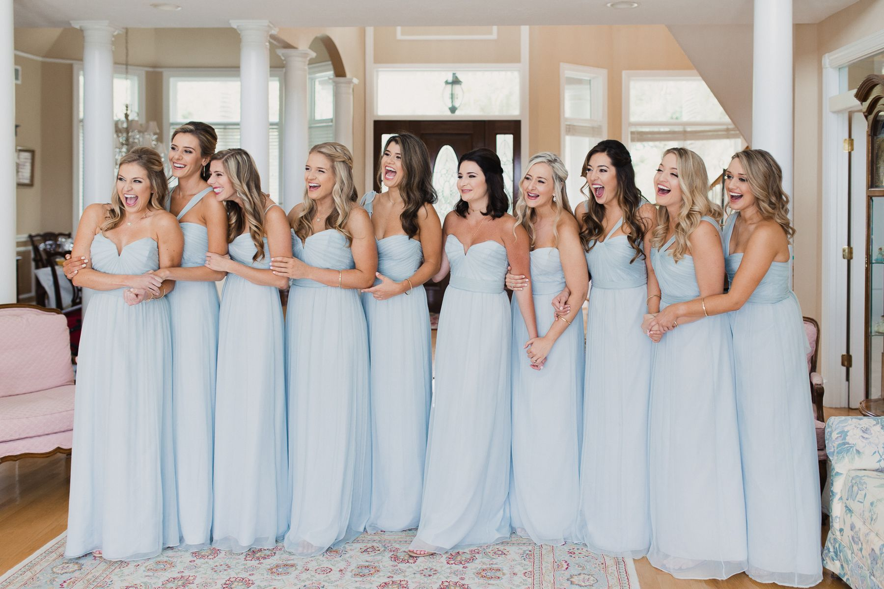 bridesmaids first look reaction in light blue dresses at tampa wedding