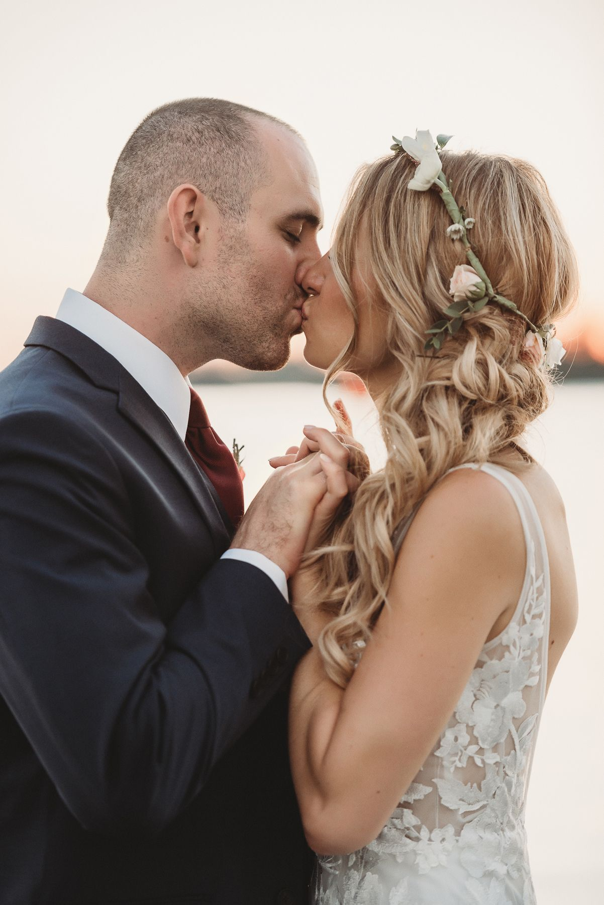 Bride and Groom Kissing at Field Club Wedding by Sarasota Wedding Photographer