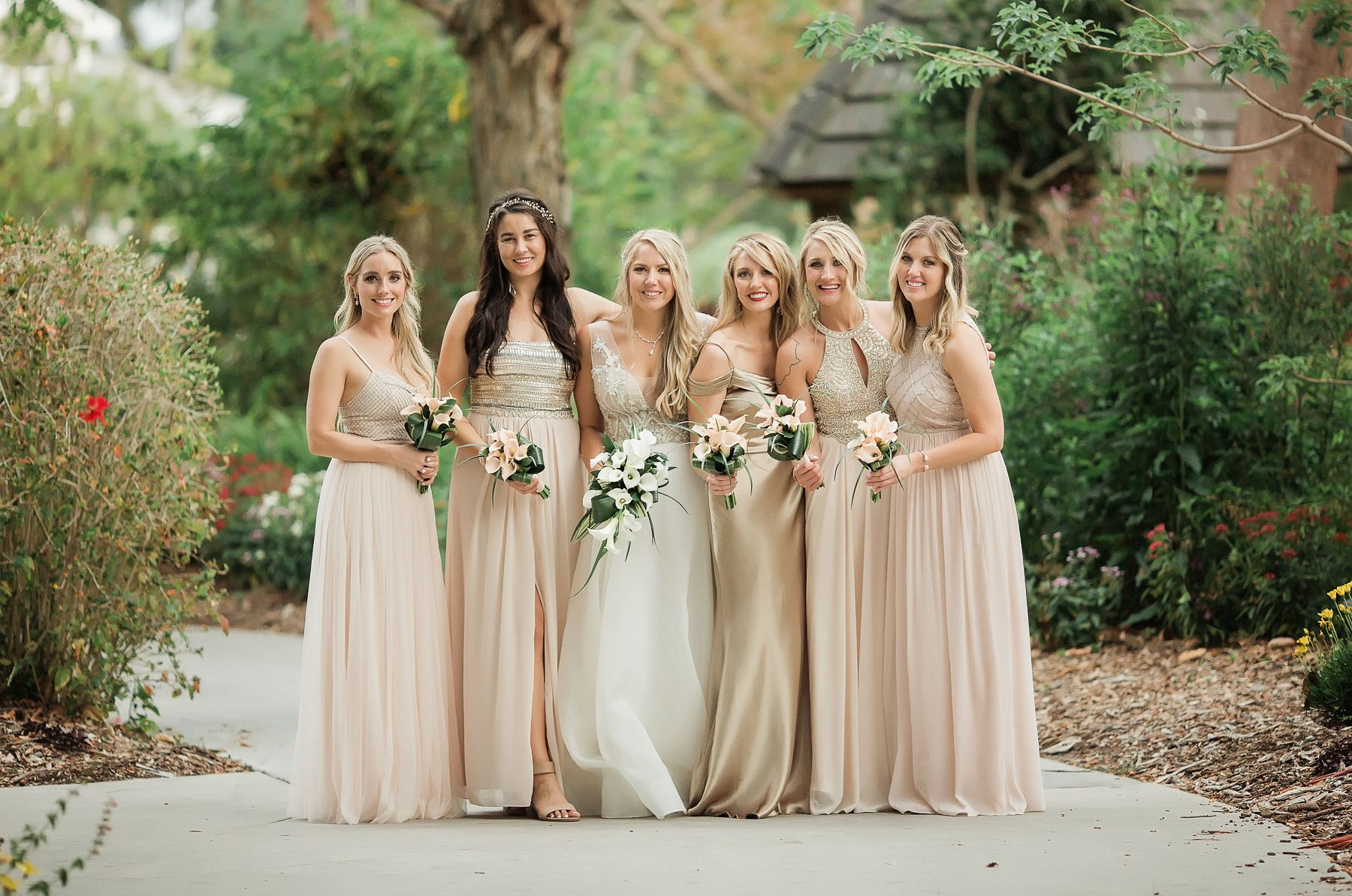bridesmaids in blush dresses at marie selby garden wedding in sarasota