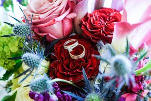ring details with flowers roses thistle blue red purple