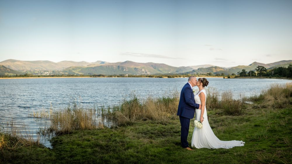 Bride and groom beside Bassenthwaite lake after Armathwaite Hall wedding