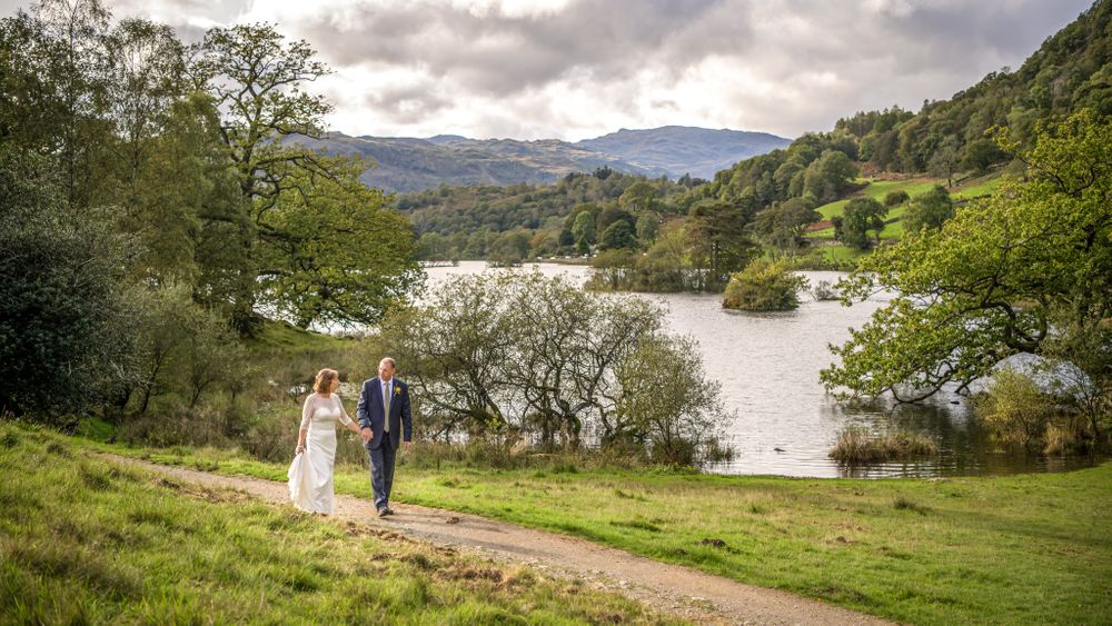 Bride and groom with Rydal Water in background