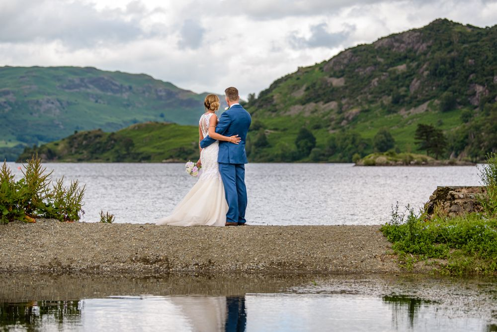 Bride and groom enjoy view over Ullswater at Inn on the Lake