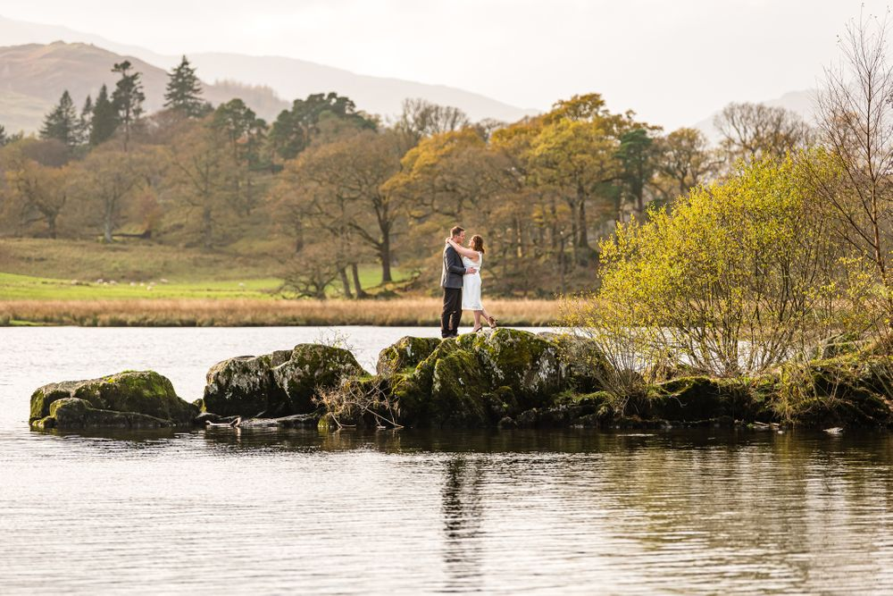 Bride and groom environmental portrait in Lake District