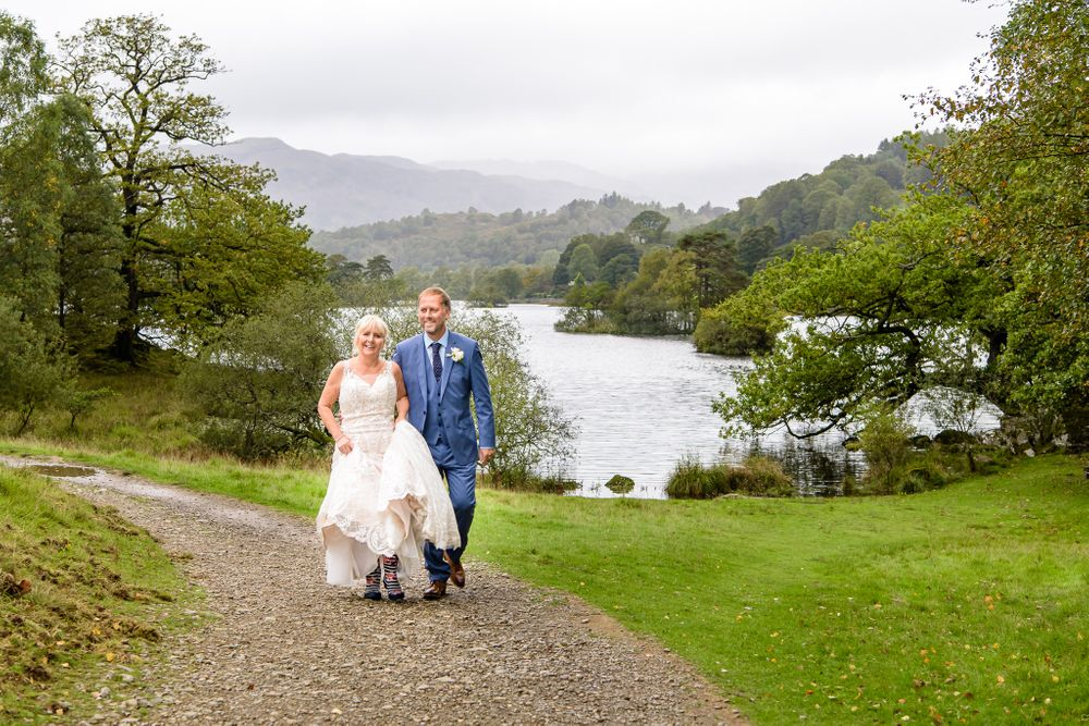 Newly weds enjoy a stroll beside Rydal Water
