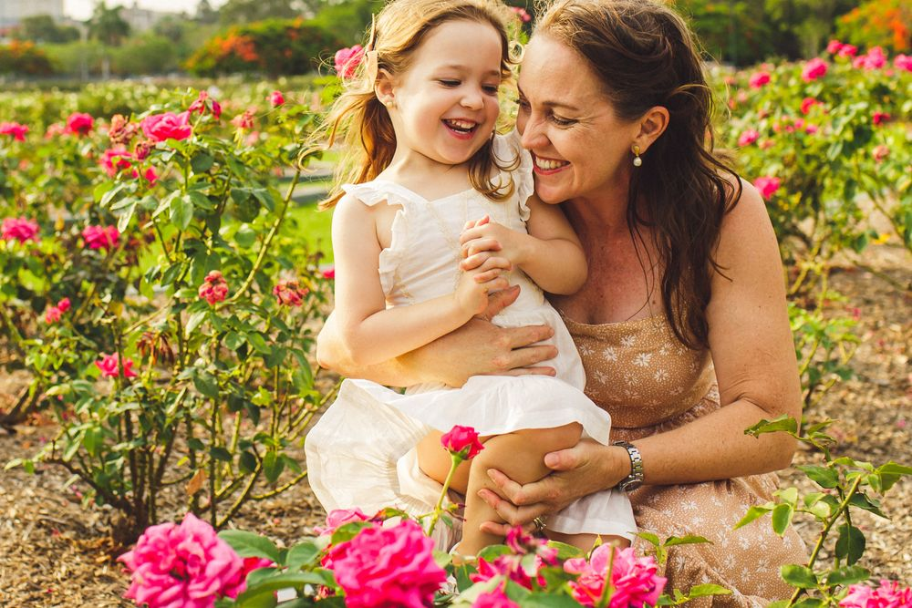 Mother and daughter in rose garden in brisbane