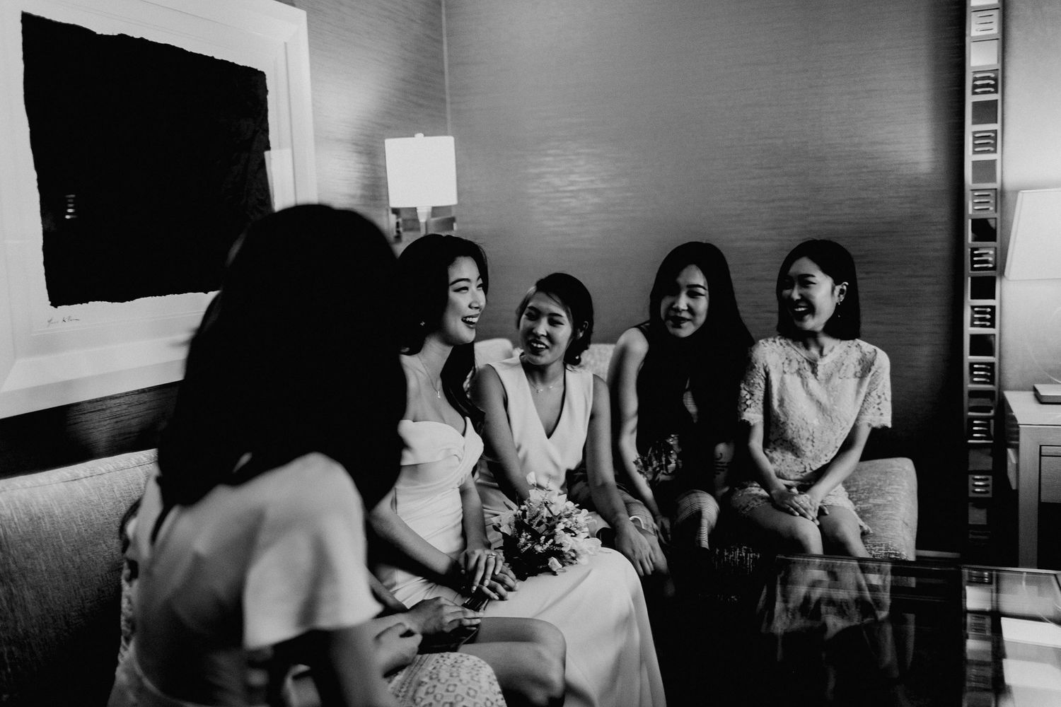 candid photo with bride and bridesmaids chatting