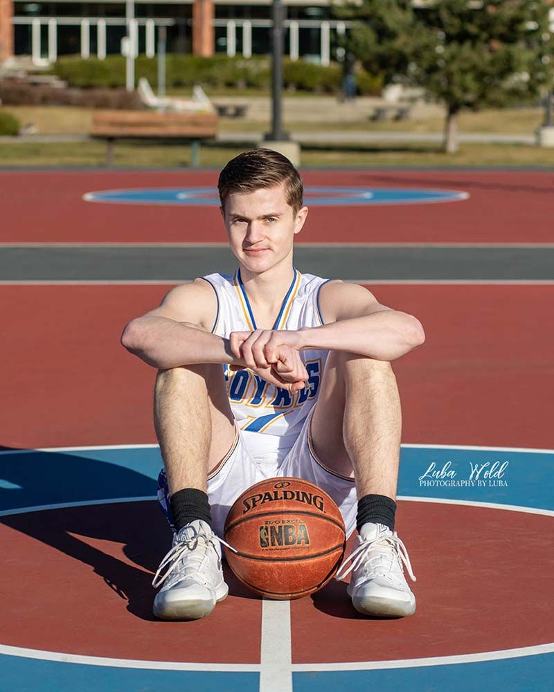 Coeur d alene high school senior boy on basketball filed photographer luba wold McEuen park