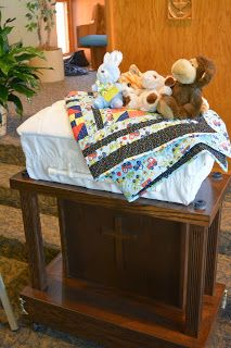 Image of Amos' casket with his stuffed animals on it during his funeral at Morningside Baptist Church in Sioux City, IA.