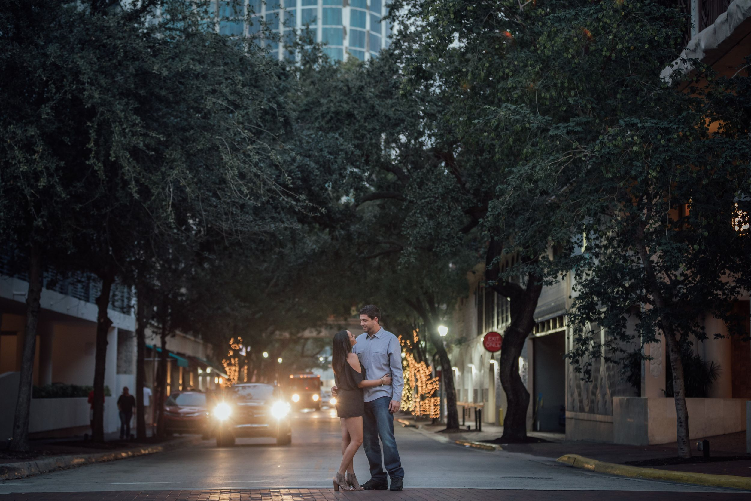 Couple embracing each other at dusk during an engagement session in Coconut grove Florida
