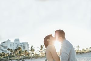 couple kissing at the beach during a sunset engagement shoot in Miami Beach