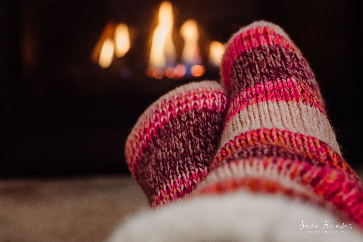 Project 365 photo of pink socks in front of fireplace