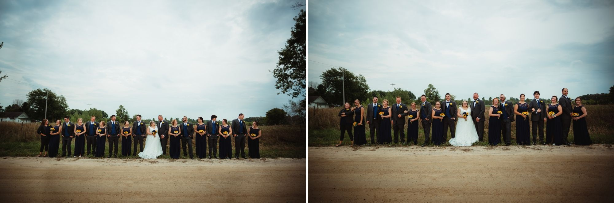 Wedding party smiling lined up on the side of a dirt road.