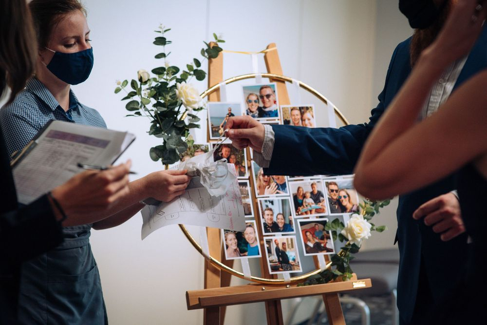 Pukrup Hall wedding by Zara Davis Photography, Gloucestershire handing out face masks