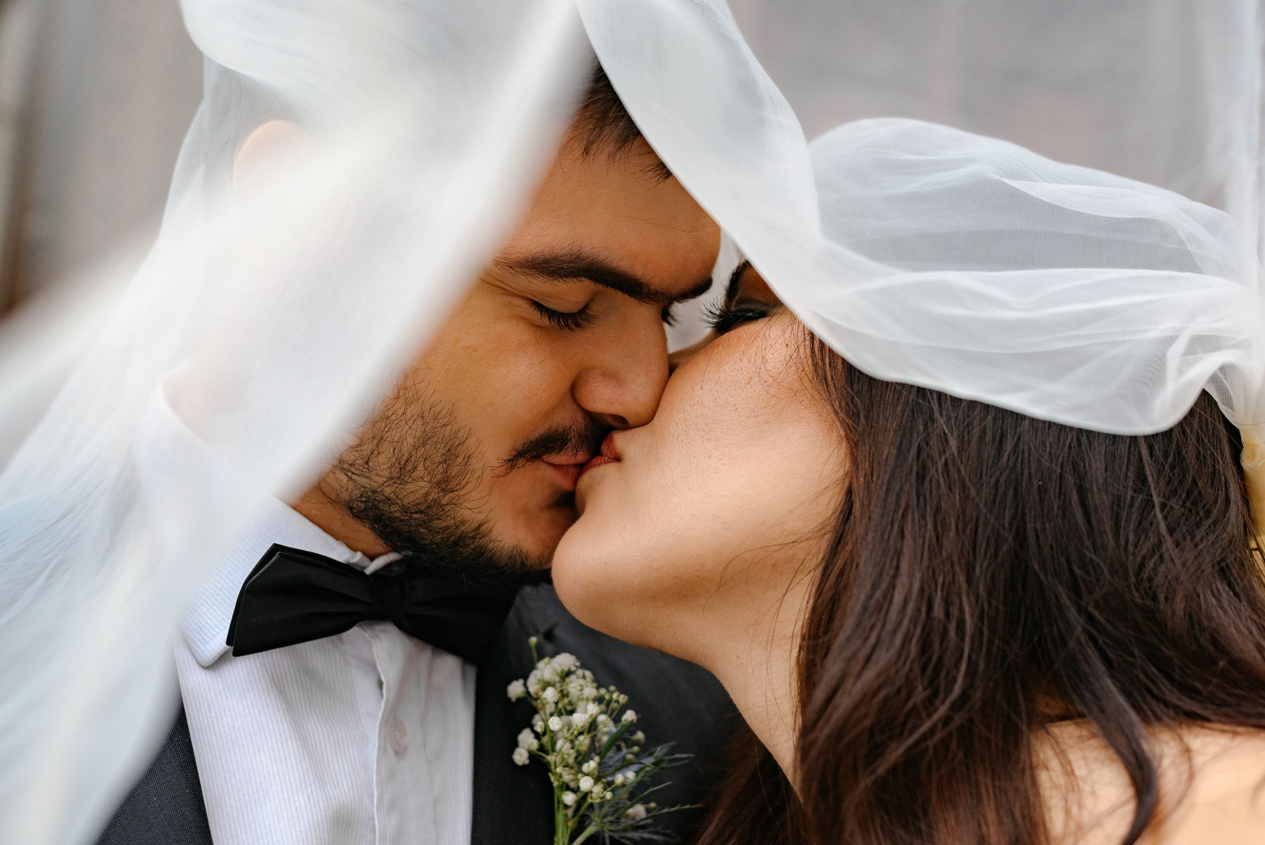 Marcella and Pablo, kiss under the wedding veil at Harkness Chapel, CWRU, Cleveland