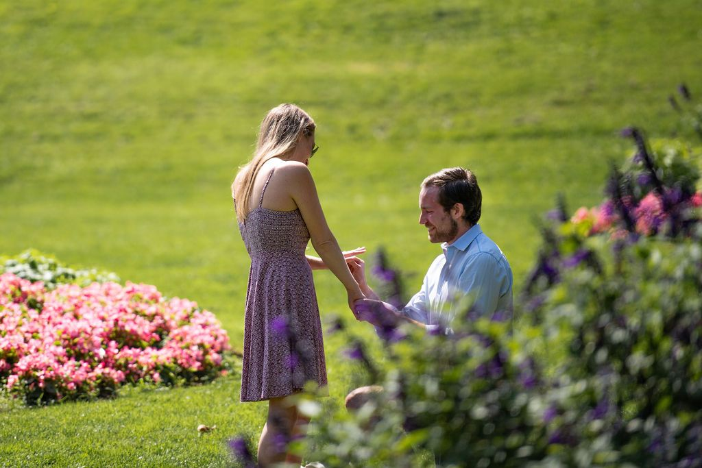 Cute couple sharing their love story through their engagement photos at a flower garden in San Francisco.