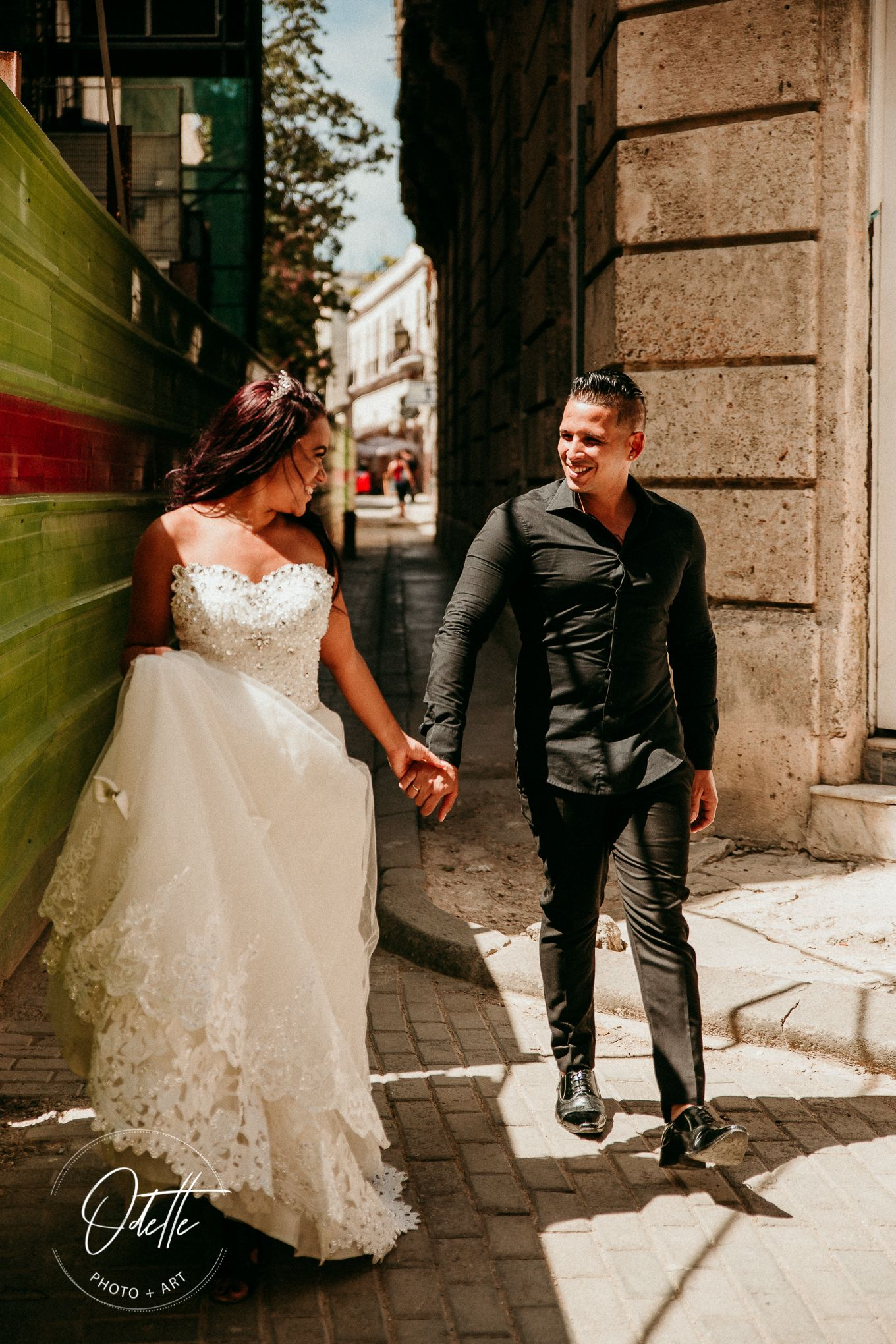 Wedding couple walking in an alley in Havana
