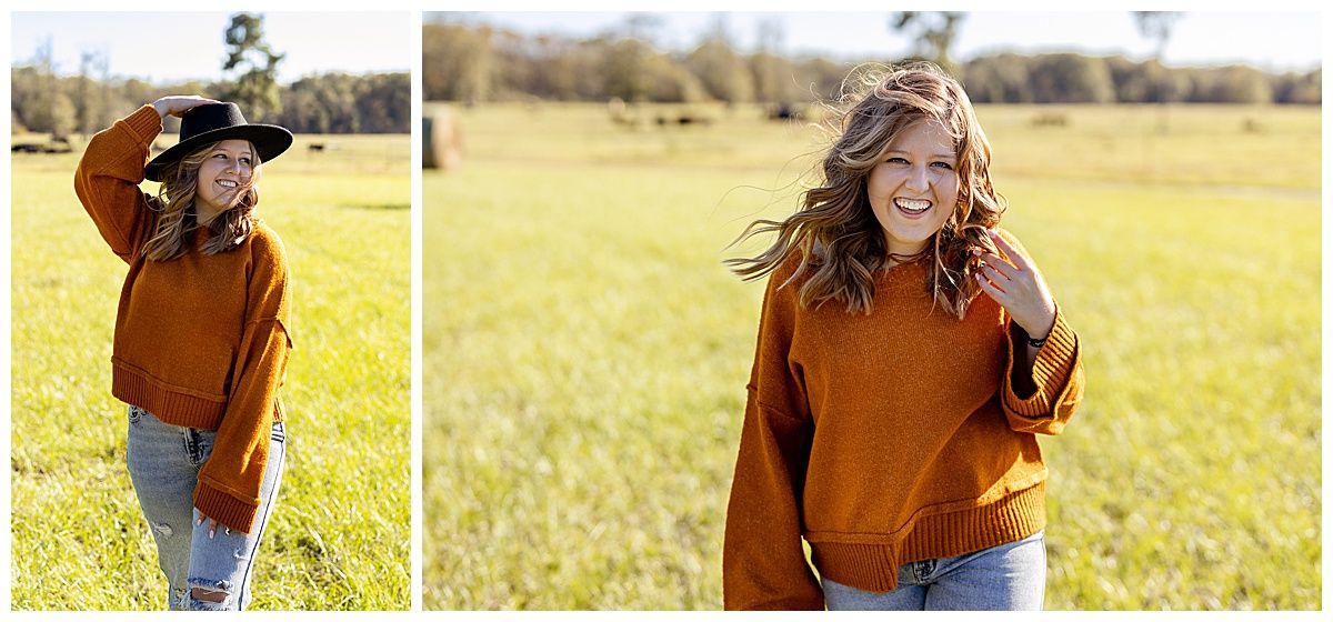 senior girl in burnt orange sweater and black hat standing in a grassy field