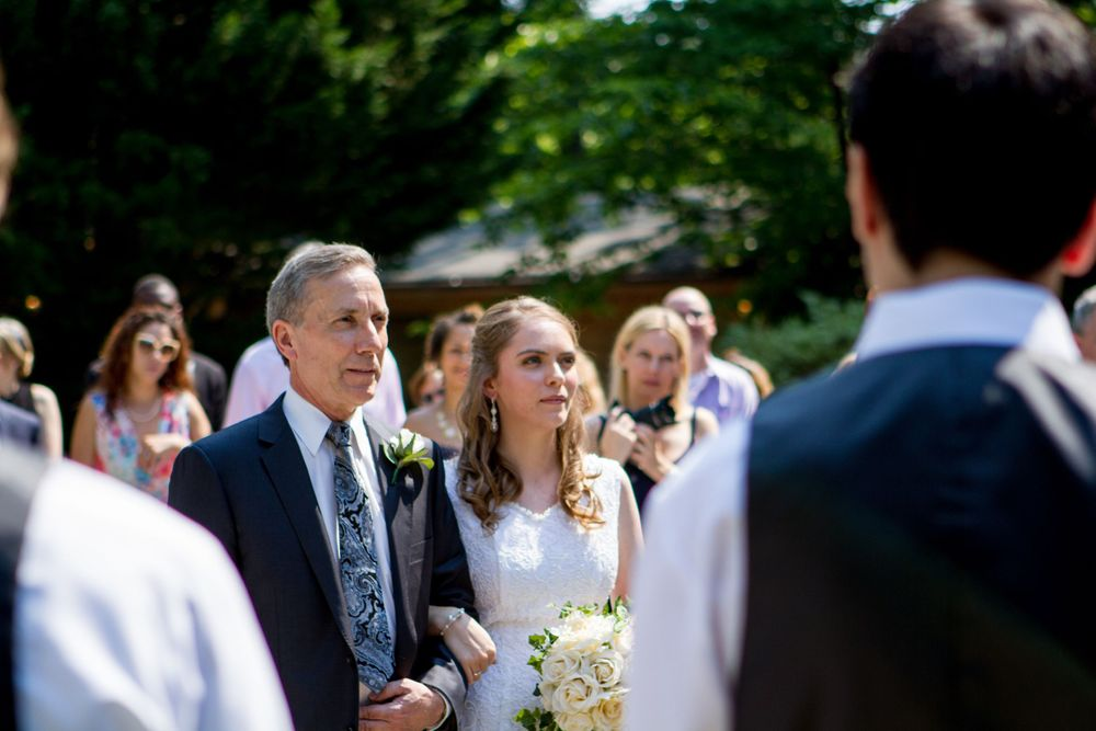 A father escorting his daughter down the aisle at a wedding
