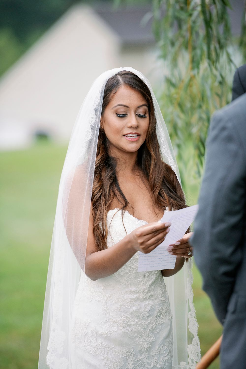 bride reading her vows during the wedding ceremony