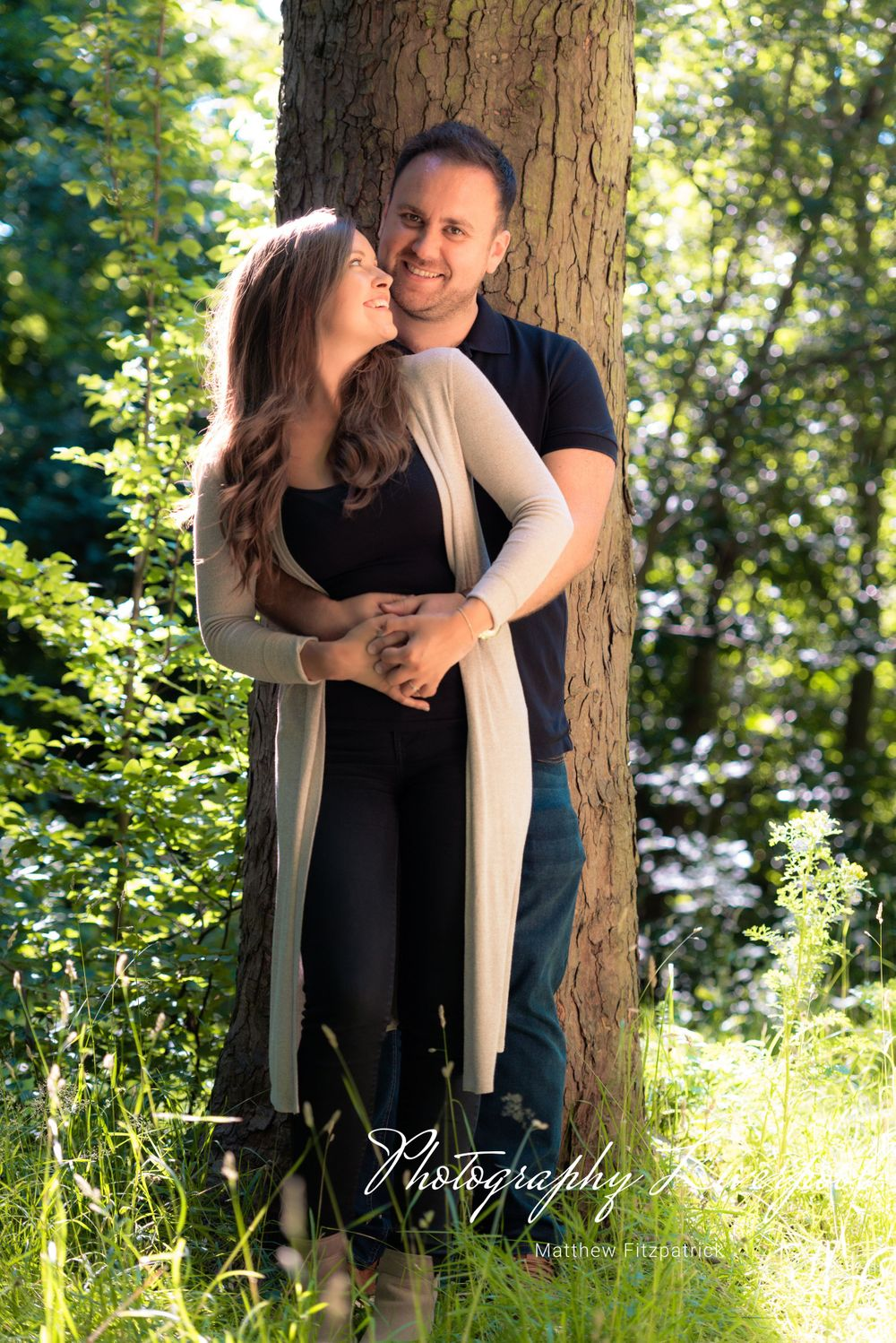 Naturally posed engagement photography at Liverpool Sefton Park by Photography Liverpool Wedding Photographer