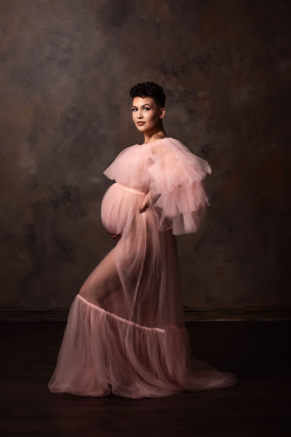 Omaha Fine Art Maternity portrait of a momma in a pink dress from Mama Bump Rentals