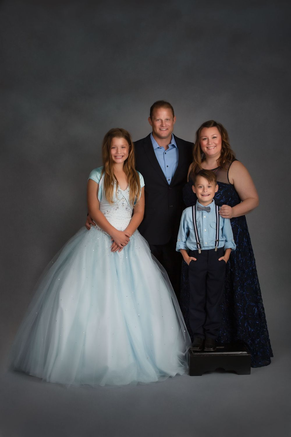 Omaha Fine Art Family portrait of family of four dressed in gowns and suits.