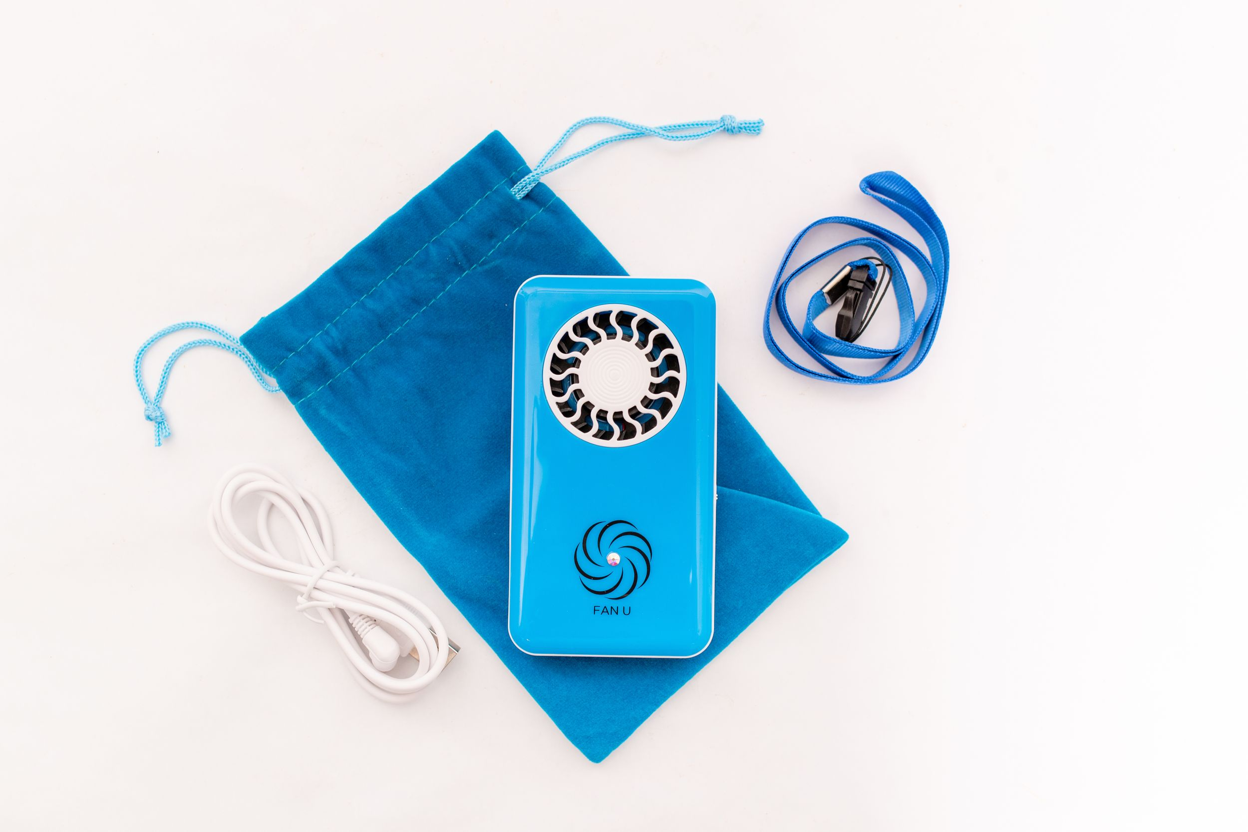 Blue electric fan with accessories and storage pouch - Product Photography
