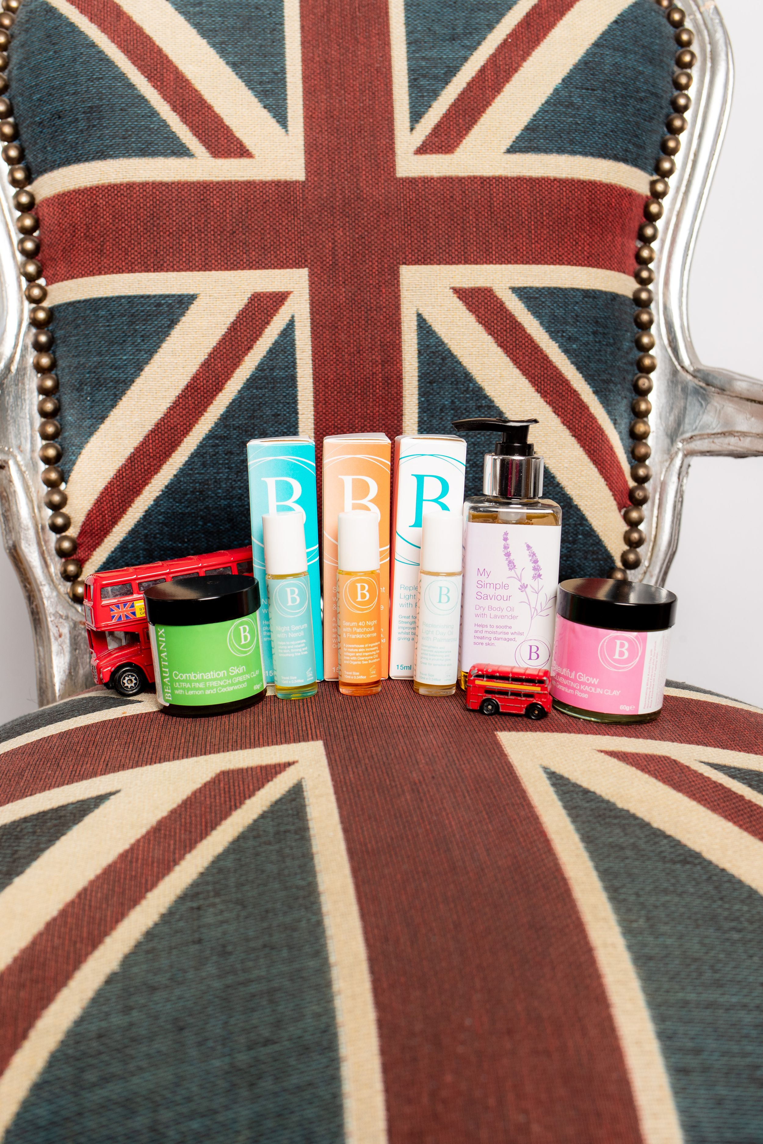 Beautanix products sit on top of a Union flag armchair with London bus - Product Photography
