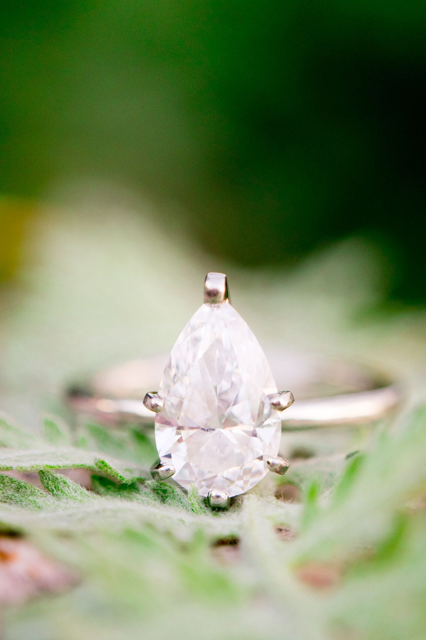 diamond pear cut engagement ring in pale green leaves