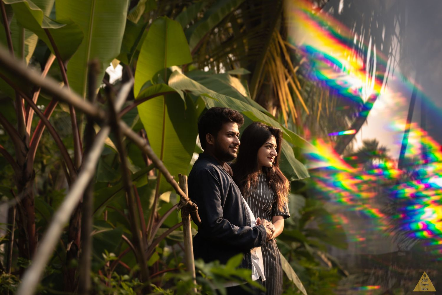 Couple shoot in garden with help of prism rainbow effect