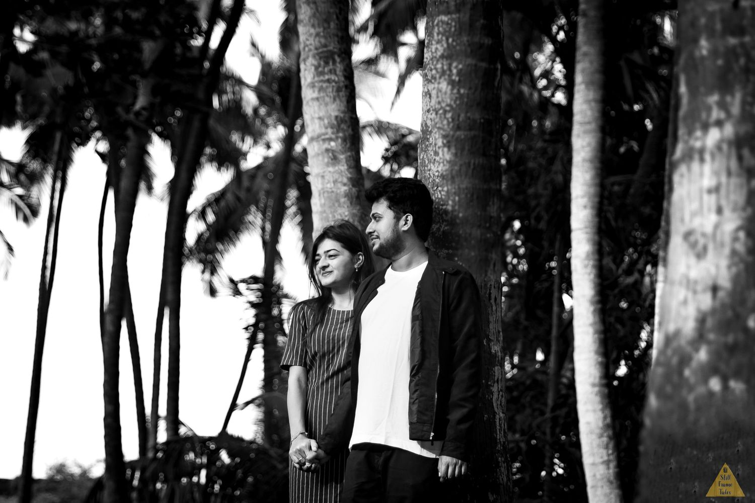 Couple enjoying cool breeze in coconut farm during a couple shoot