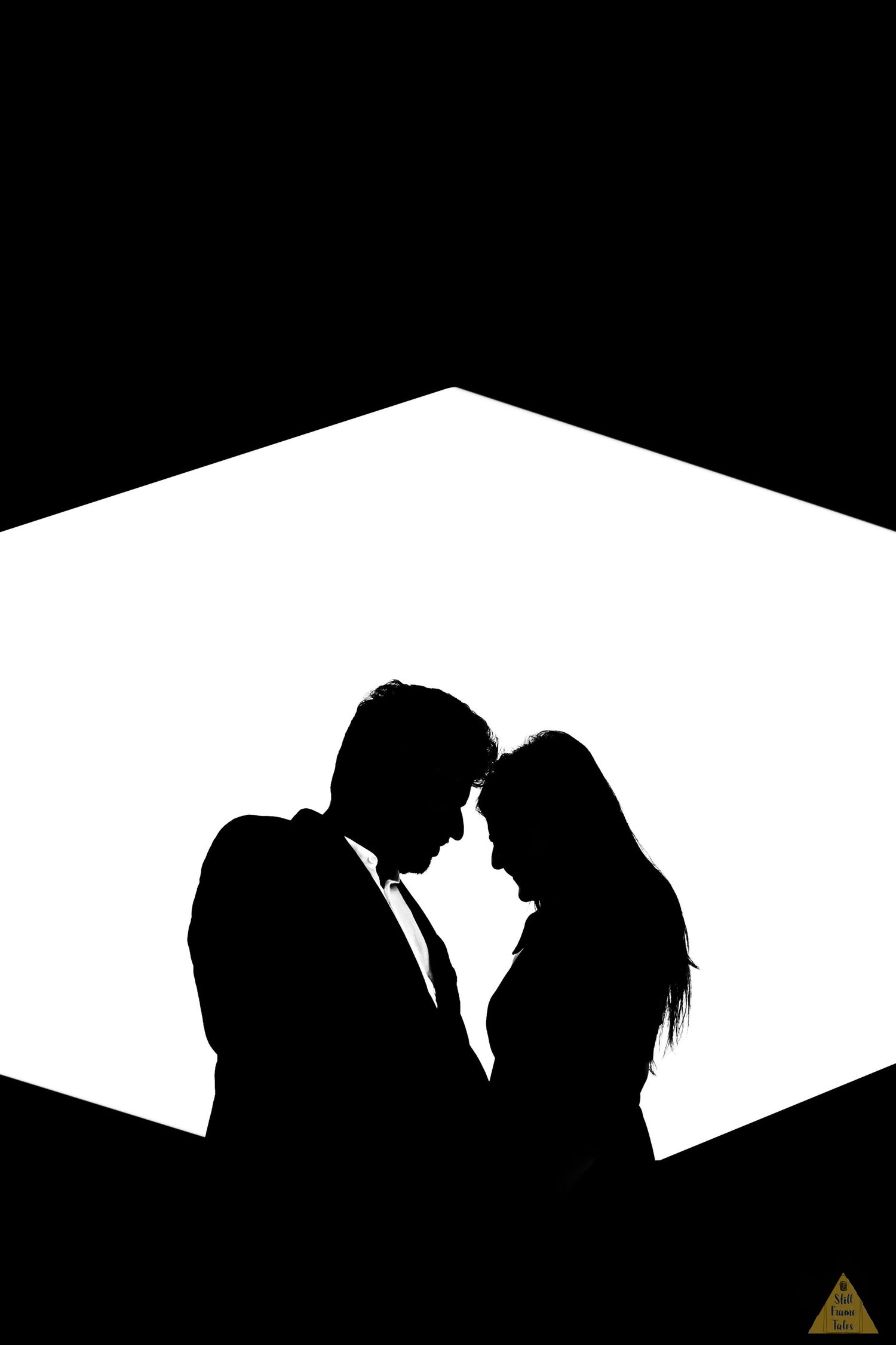 Couple silhouette in a artistic hexagonal shape background with black & white shade