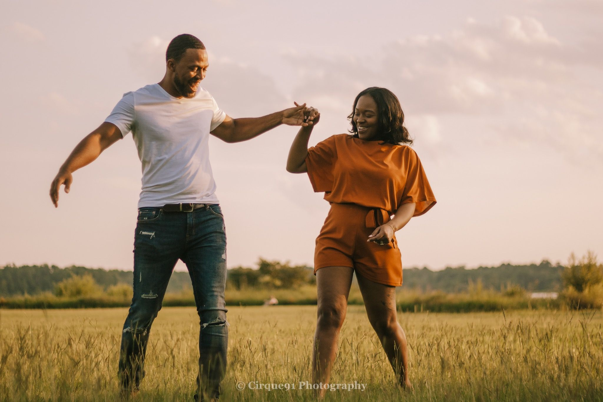 couple dancing in the field in raleigh north carolina