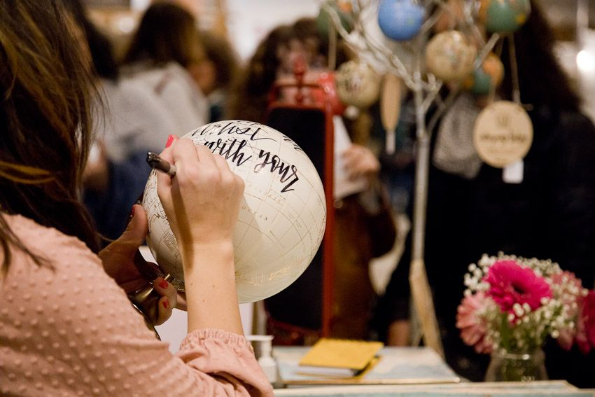 Pinology Puyallup Mia Nicole Booth Handmade calligraphy on globes while working in booth